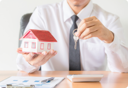 house-key-home-insurance-broker-agent-s-hand-protection