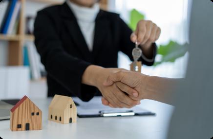 sales-representative-shake-hands-delivering-keys-new-homeowners